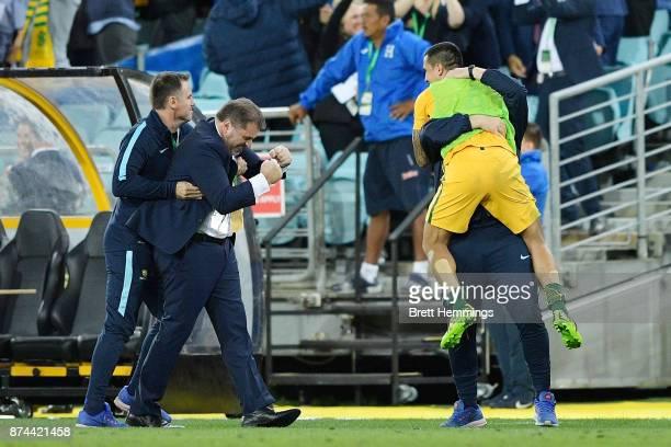 Ange Postecoglou coach of Australia and Tim Cahill of Australia celebrate Mile Jedinak's goal during the 2018 FIFA World Cup Qualifiers Leg 2 match...