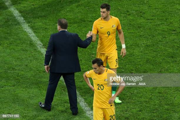 Ange Postecoglou head coach / manager of Australia shakes hands with Tomi Juric of Australia during the FIFA Confederations Cup Russia 2017 Group B...