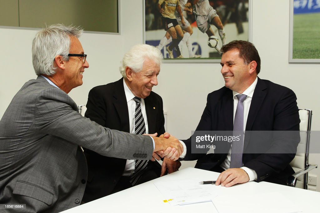 Ange Postecoglou (R) shakes hands with FFA CEO David Gallop (L) and FFA Chairman Frank Lowy (C) before a press conference at the FFA Headquarters on October 23, 2013 in Sydney, Australia. The FFA today announced Postecoglou as the Socceroos new head coach through to the 2018 World Cup.