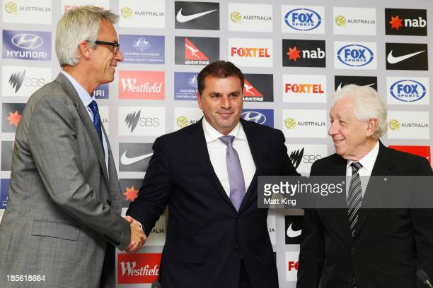 Ange Postecoglou shakes hands with FFA CEO David Gallop and FFA Chairman Frank Lowy during a press conference at the FFA Headquarters on October 23...