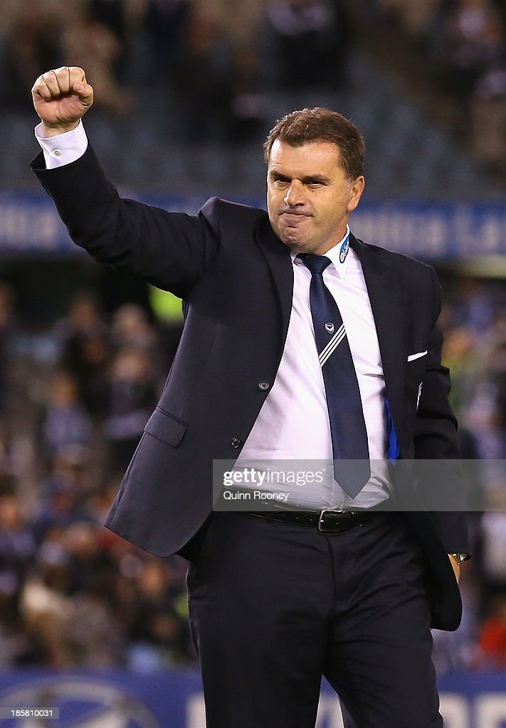 <a gi-track='captionPersonalityLinkClicked' href=/galleries/search?phrase=Ange+Postecoglou&family=editorial&specificpeople=3395755 ng-click='$event.stopPropagation()'>Ange Postecoglou</a> the coach of the Victory celebrates to the crowd after winning his final game as coach during the round three A-League match between Melbourne Victory and Brisbane Roar at Etihad Stadium on October 25, 2013 in Melbourne, Australia.