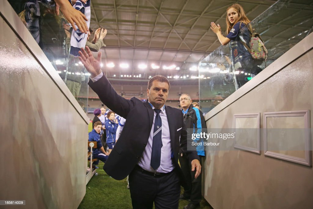 <a gi-track='captionPersonalityLinkClicked' href=/galleries/search?phrase=Ange+Postecoglou&family=editorial&specificpeople=3395755 ng-click='$event.stopPropagation()'>Ange Postecoglou</a> the coach of the Victory leaves the field after winning his final game as coach during the round three A-League match between Melbourne Victory and Brisbane Roar at Etihad Stadium on October 25, 2013 in Melbourne, Australia.