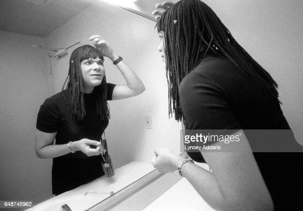 Angel adjusts her wig after dressing in a public bathroom at the Gay Man's Health Crisis Center in the West Village of New York City in September...