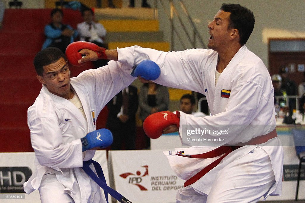 Angel Aponte (R) of Venezuela competes against Jose Ramirez of Colombia in Karate free category as part of the XVII Bolivarian Games Trujillo 2013 at San Jose Obrero Coliseum on November 29, 2013 in Trujillo, Peru.