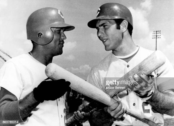 Angel Bravo and Bernie Carbo of the Cincinnati Reds pose with their baseball bats during Spring Training on March 19 1970 in Cocoa Florida
