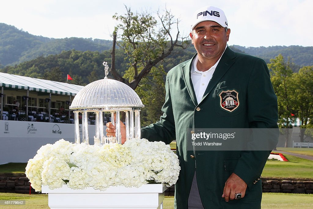 Angel Cabrera of Argentina holds the trophy after winning the Greenbrier Classic at the Old White TPC on July 6 2014 in White Sulphur Springs West...