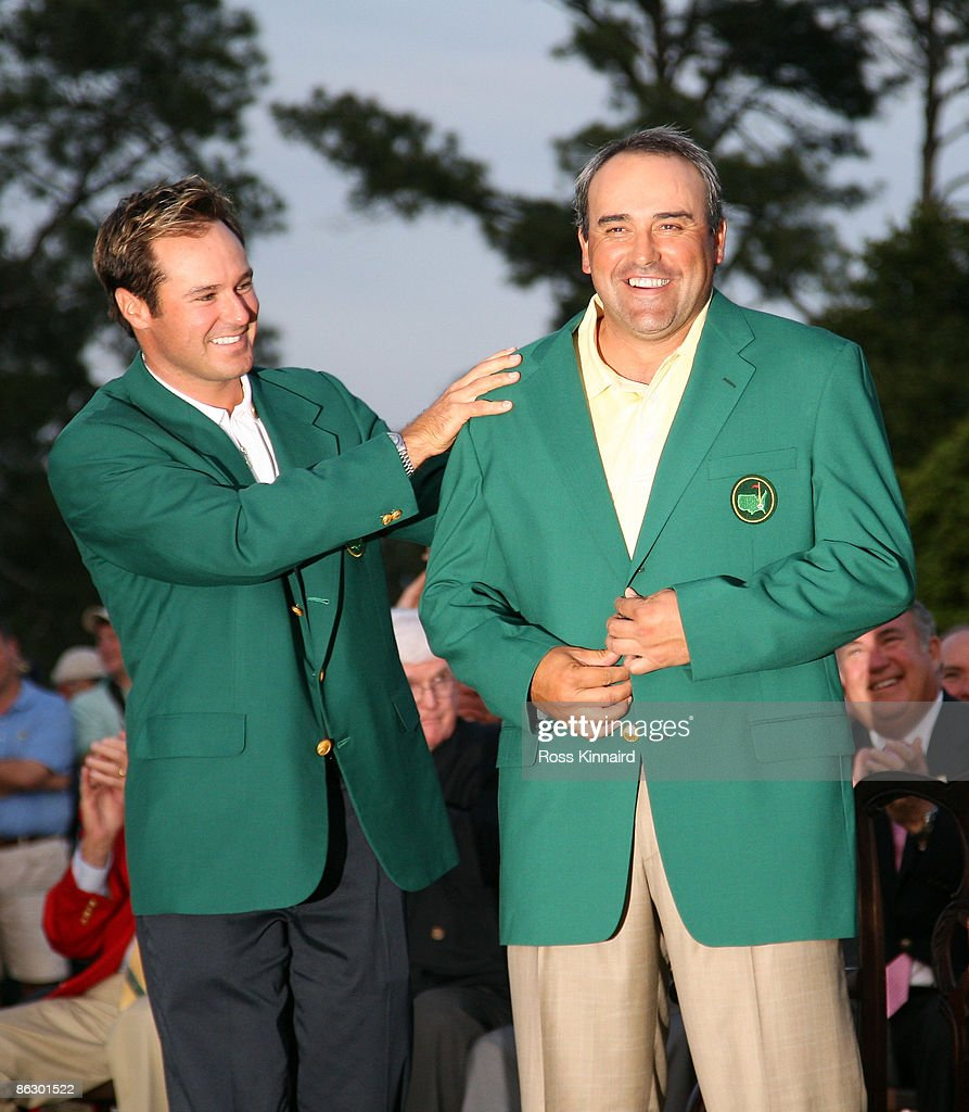 Angel Cabrera of Argentina is presented with his Green Jacket by Trevor Immelman of South Africa during the final round of the 2009 Masters Tournament at Augusta National Golf Club on April 12, 2009 in Augusta, Georgia.