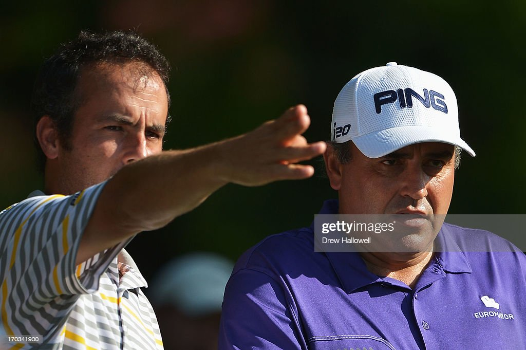 Angel Cabrera (R) of Argentina lines up a tee shot during a practice round prior to the start of the 113th U.S. Open at Merion Golf Club on June 11, 2013 in Ardmore, Pennsylvania.
