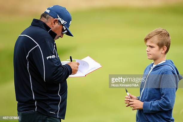 Angel Cabrera of Argentina signs his autograph for a fan during a practice round prior to the start of the 143rd Open Championship at Royal Liverpool...