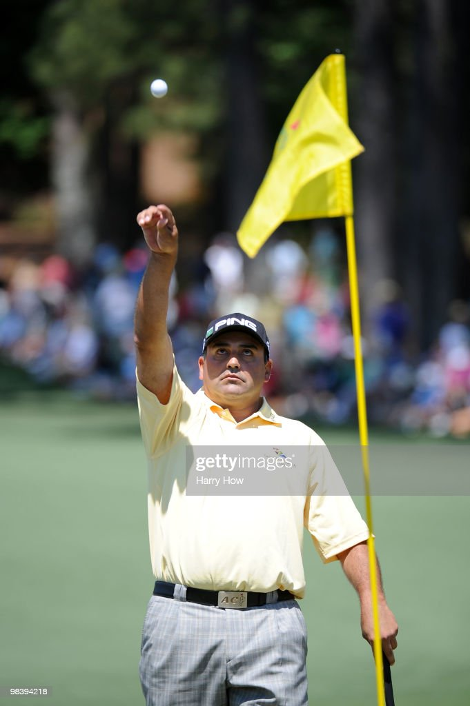 Angel Cabrera of Argentina tosses his golf ball to his caddie on the second hole during the final round of the 2010 Masters Tournament at Augusta...