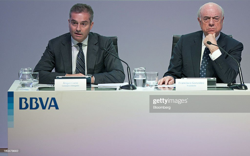 Angel Cano, president and chief operating officer of Banco Bilbao Vizcaya Argentaria SA (BBVA), left, speaks as Francisco Gonzalez, chairman of Banco Bilbao Vizcaya Argentaria SA (BBVA), listens during a news conference to announce the company's fourth-quarter results in Madrid, Spain, on Friday, Feb. 1, 2013. BBVA, Spain's second-biggest bank, posted a 20 million-euro ($27.3 million) fourth-quarter profit as a revenue boost offset costs of completing a cleanup of Spanish real estate assets. Photographer: Angel Navarrete/Bloomberg via Getty Images