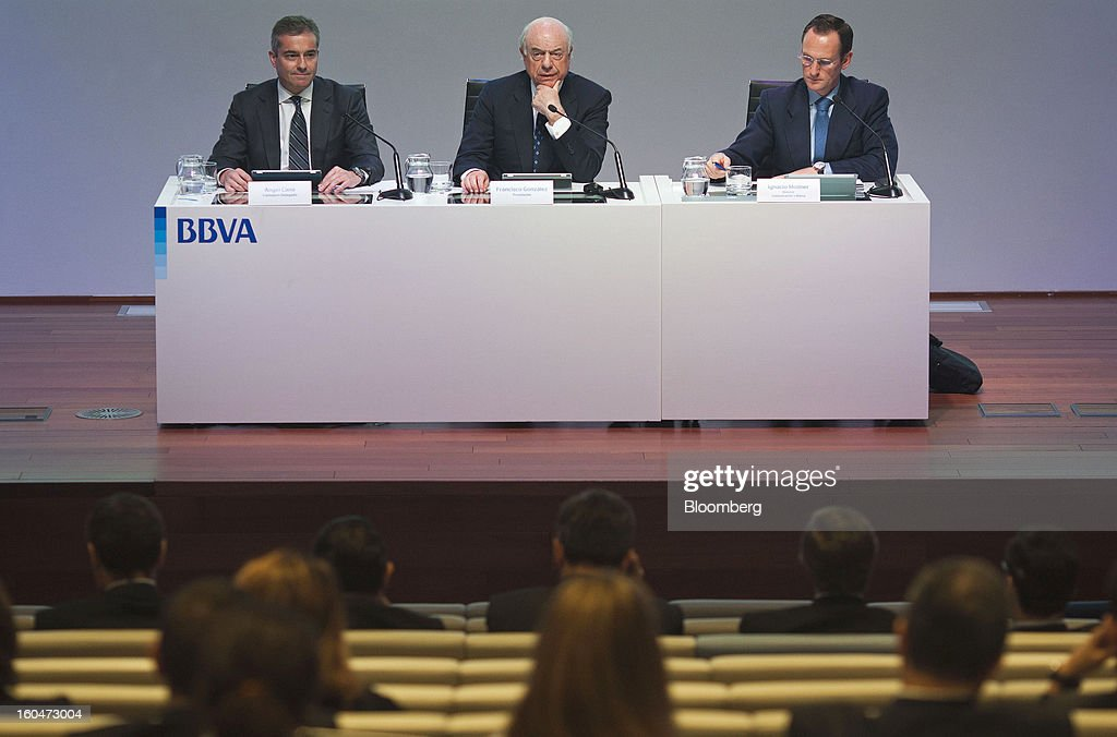 Angel Cano, president and chief operating officer of Banco Bilbao Vizcaya Argentaria SA (BBVA), left, <a gi-track='captionPersonalityLinkClicked' href=/galleries/search?phrase=Francisco+Gonzalez+-+Spanish+banker&family=editorial&specificpeople=8284524 ng-click='$event.stopPropagation()'>Francisco Gonzalez</a>, chairman of Banco Bilbao Vizcaya Argentaria SA (BBVA), center, and Ignacio Moliner, a press officer for Banco Bilbao Vizcaya Argentaria SA (BBVA), attend a news conference to announce the company's fourth-quarter results in Madrid, Spain, on Friday, Feb. 1, 2013. BBVA, Spain's second-biggest bank, posted a 20 million-euro ($27.3 million) fourth-quarter profit as a revenue boost offset costs of completing a cleanup of Spanish real estate assets. Photographer: Angel Navarrete/Bloomberg via Getty Images