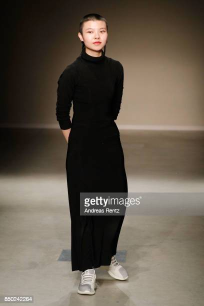 Angel Chen acknowledges the applause of the audience at the show during Milan Fashion Week Spring/Summer 2018 on September 20 2017 in Milan Italy