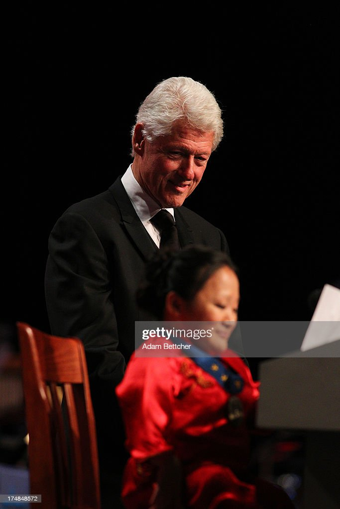 'Angel' Chun Li Zhao speaks while former President <a gi-track='captionPersonalityLinkClicked' href=/galleries/search?phrase=Bill+Clinton&family=editorial&specificpeople=67203 ng-click='$event.stopPropagation()'>Bill Clinton</a> listens during the 2013 Starkey Hearing Foundation's 'So the World May Hear' Awards Gala on July 28, 2013 in St. Paul, Minnesota.