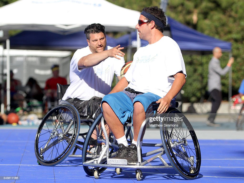 Angel City Games director Michael Garafola and comedian Adam Sandler play in a celebrity wheelchair basketball game during the 2nd Annual Angel City...