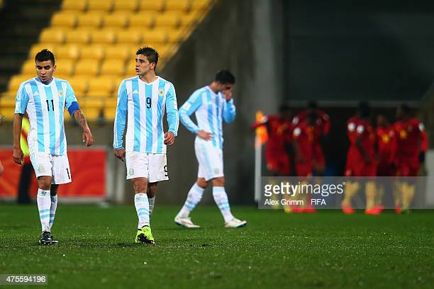 Angel Correa and Giovanni Simeone of Argentina react as players of Ghana celebrates their team's first goal during the FIFA U20 World Cup New Zealand...