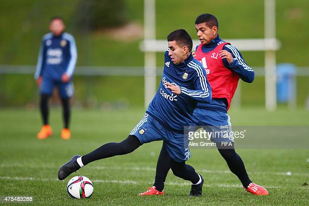 Angel Correa is challenged by Daniel Ibanez during an Argentina U20s training session at Porirua Park on June 1 2015 in Wellington New Zealand