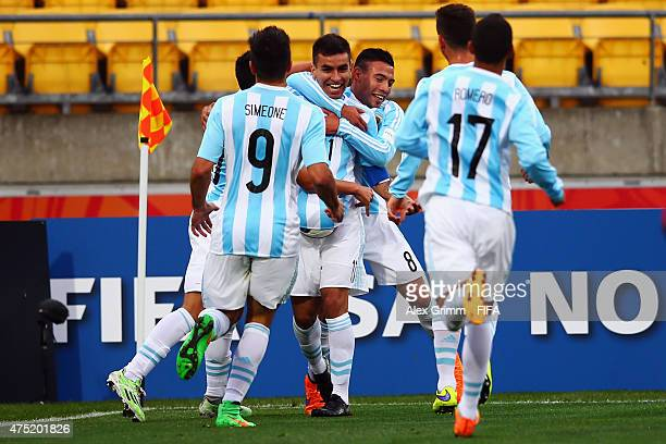 Angel Correa of Argentina celebrates his team's first goal with team mates during the FIFA U20 World Cup New Zealand 2015 Group B match between...