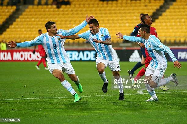 Angel Correa of Argentina celebrates his team's second goal with team mates Giovanni Simeone and Cristian Espinoza during the FIFA U20 World Cup New...