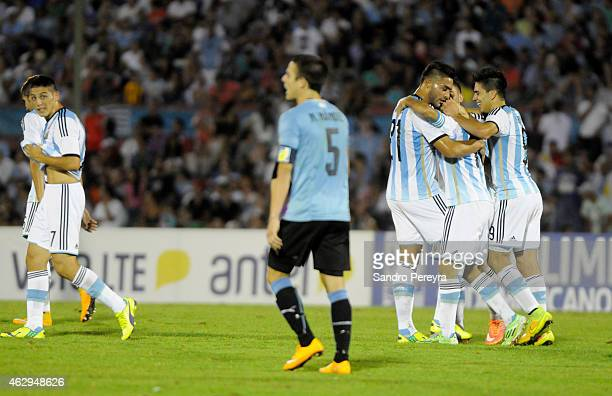 Angel Correa of Argentina celebrates with teammates after scoring the second goal of his team during a match between Argentina and Uruguay as part of...