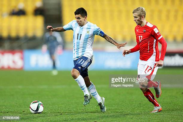 Angel Correa of Argentina holds off the challenge of Konrad Lahmer of Austria during the FIFA U20 World Cup New Zealand 2015 Group B match between...