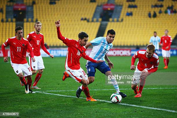 Angel Correa of Argentina is challenged by Alexander Joppich and Lukas Gugganig of Austria during the FIFA U20 World Cup New Zealand 2015 Group B...