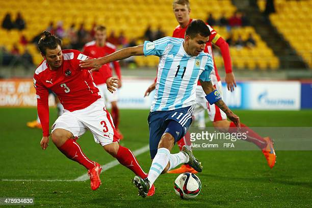 Angel Correa of Argentina is challenged by Daniel Rosenbichler of Austria during the FIFA U20 World Cup New Zealand 2015 Group B match between...