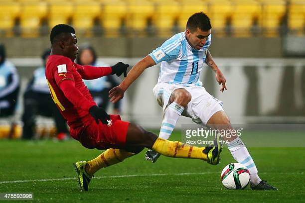 Angel Correa of Argentina is challenged by Joseph Aidoo of Ghana during the FIFA U20 World Cup New Zealand 2015 Group B match between Argentina and...