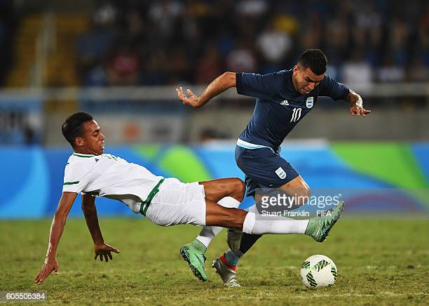 Angel Correa of Argentina is challenged by Sofiiane Bendebka of Algeria during the Olympic Men's Football match between Argentina and Algeria at...