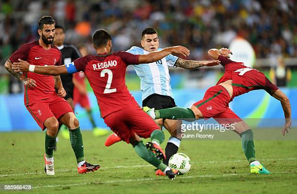 Angel Correa of Argentina is surrounded by the Portugal defence during the Men's Group D first round match between Portugal and Argentina during the...