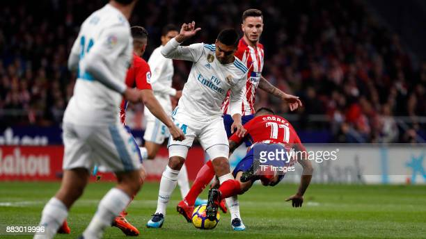 Angel Correa of Atletico de Madrid and Casemiro of Real Madrid battle for the ball during a match between Atletico Madrid and Real Madrid as part of...