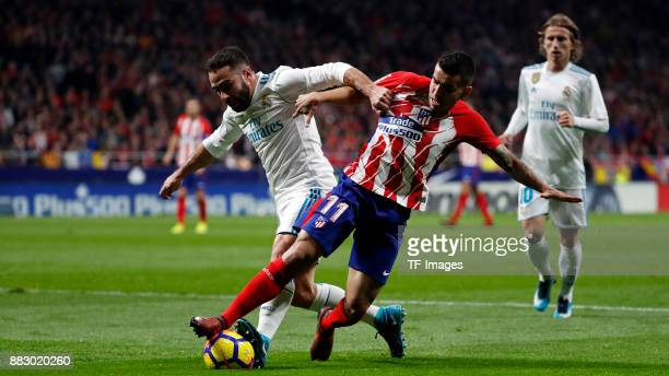 Angel Correa of Atletico de Madrid and Dani Carvajal of Real Madrid battle for the ball during a match between Atletico Madrid and Real Madrid as...