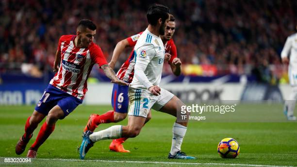 Angel Correa of Atletico de Madrid and Isco Alarcon of Real Madrid battle for the ball during a match between Atletico Madrid and Real Madrid as part...