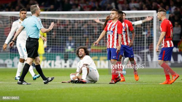 Angel Correa of Atletico de Madrid and Marcelo of Real Madrid look on during a match between Atletico Madrid and Real Madrid as part of La Liga at...