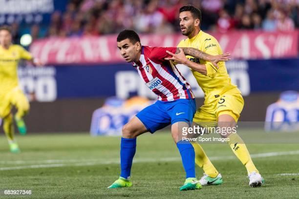 Angel Correa of Atletico de Madrid and Mateo Pablo Musacchio of Villarreal CF in action during the La Liga match between Atletico de Madrid vs...