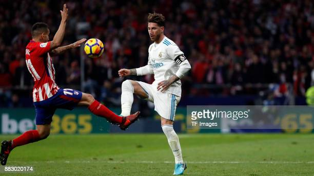 Angel Correa of Atletico de Madrid and Sergio Ramos of Real Madrid battle for the ball during a match between Atletico Madrid and Real Madrid as part...
