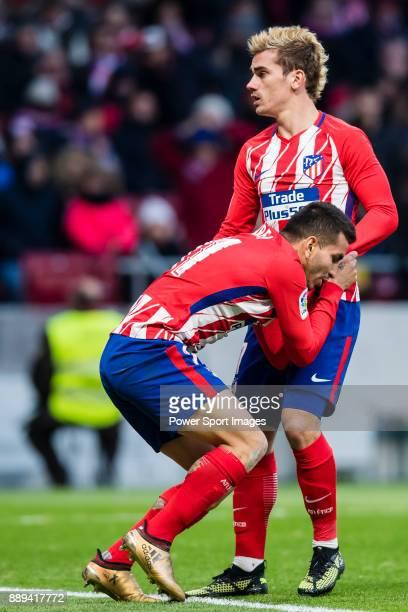 Angel Correa of Atletico de Madrid assisted by Antoine Griezmann of Atletico de Madrid during the La Liga 201718 match between Atletico de Madrid and...