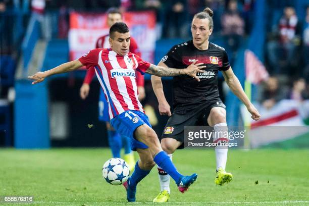 Angel Correa of Atletico de Madrid battles for the ball with Julian Baumgartlinger of Bayer 04 Leverkusen during their 201617 UEFA Champions League...