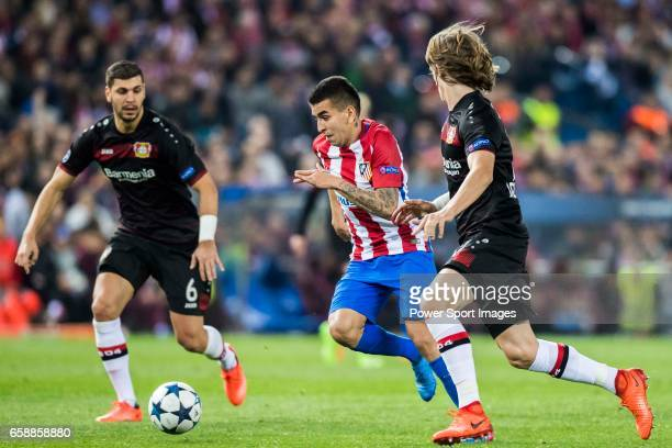 Angel Correa of Atletico de Madrid competes for the ball with Tin Jedvaj of Bayer 04 Leverkusen during their 201617 UEFA Champions League Round of 16...