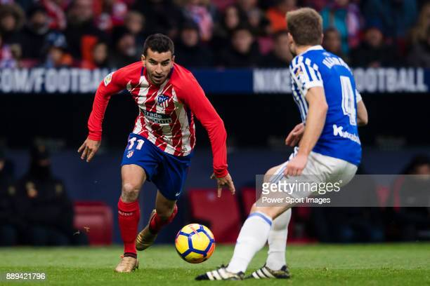 Angel Correa of Atletico de Madrid fights for the ball with Asier Illarramendi Andonegi of Real Sociedad during the La Liga 201718 match between...