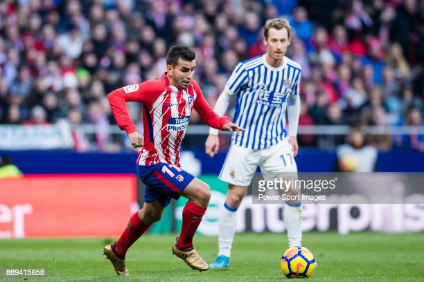 Angel Correa of Atletico de Madrid fights for the ball with David Zurutuza Veillet of Real Sociedad during the La Liga 201718 match between Atletico...
