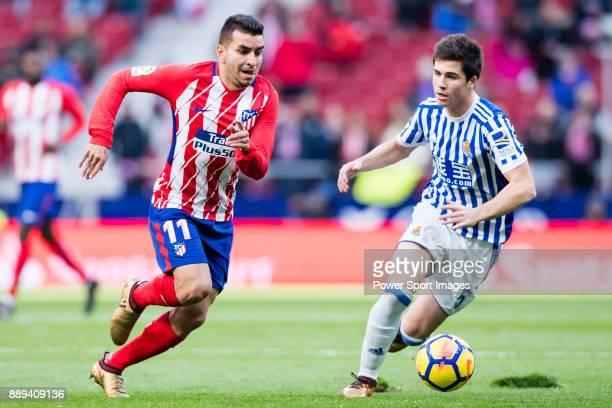 Angel Correa of Atletico de Madrid fights for the ball with Igor Zubeldia of Real Sociedad during the La Liga 201718 match between Atletico de Madrid...