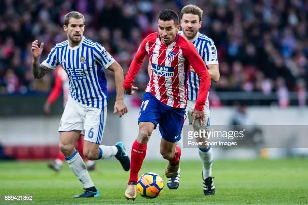 Angel Correa of Atletico de Madrid fights for the ball with Inigo Martinez Berridi of Real Sociedad and Asier Illarramendi Andonegi of Real Sociedad...
