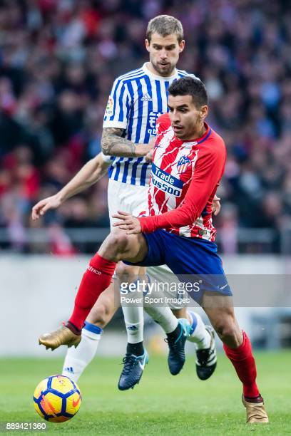 Angel Correa of Atletico de Madrid fights for the ball with Inigo Martinez Berridi of Real Sociedad during the La Liga 201718 match between Atletico...