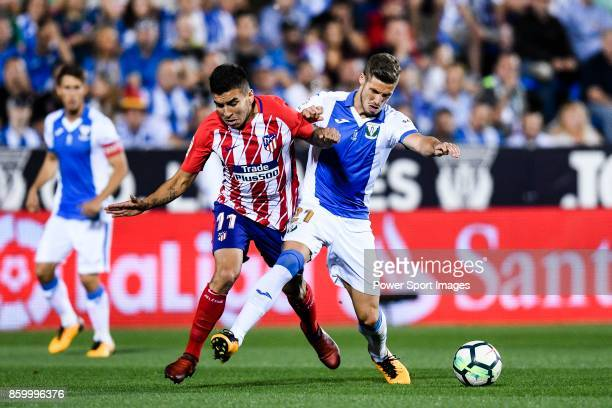 Angel Correa of Atletico de Madrid fights for the ball with Ruben Salvador Perez del Marmol of CD Leganes during the La Liga 201718 match between CD...