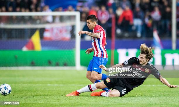 Angel Correa of Atletico de Madrid fights for the ball with Tin Jedvaj of Bayer 04 Leverkusen during their 201617 UEFA Champions League Round of 16...