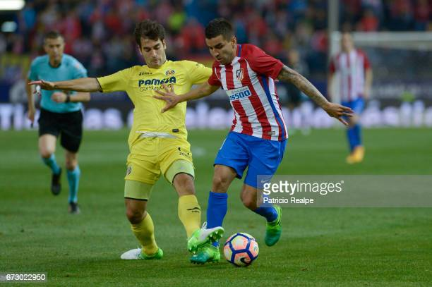 Angel Correa of Atletico de Madrid fights the ball with Samu Castillejo of Villareal during a match between Atletico Madrid v Villarreal as part of...