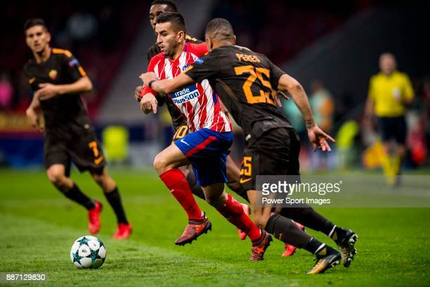 Angel Correa of Atletico de Madrid flights the ball with Bruno Peres of AS Roma during the UEFA Champions League 201718 match between Atletico de...