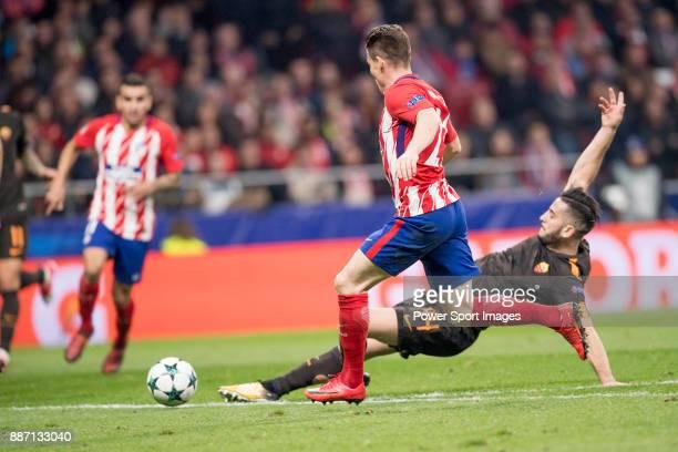 Angel Correa of Atletico de Madrid flights the ball with Kostas Manolas of AS Roma during the UEFA Champions League 201718 match between Atletico de...