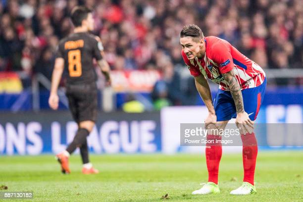 Angel Correa of Atletico de Madrid runs with the ball during the UEFA Champions League 201718 match between Atletico de Madrid and AS Roma at Wanda...